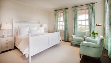 traditional bedroom with tan walls and mint green accents