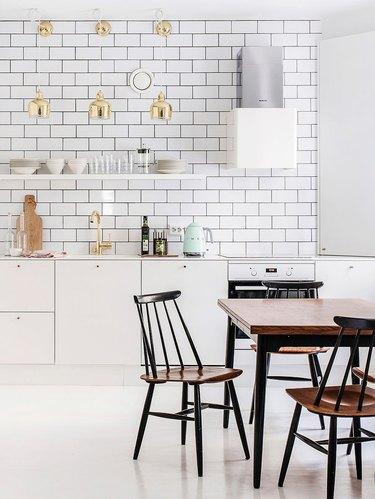all white scandinavian kitchen with subway tile backsplash