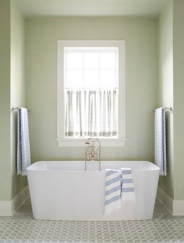 mint green bathroom with baby blue towels