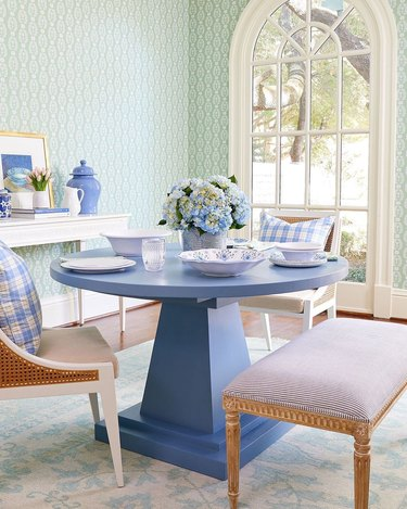 mint green dining room with periwinkle dining table