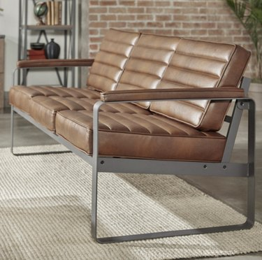 Metal and leather couch in industrial room