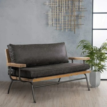 Wood and leather brown couch