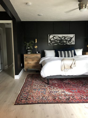 black bedroom with black and white abstract painting