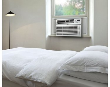 LG window air conditioner in gray and white bedroom