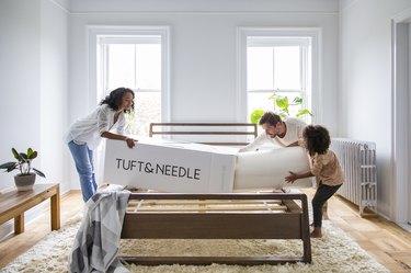 family unpacks a Tuft & Needle mattress