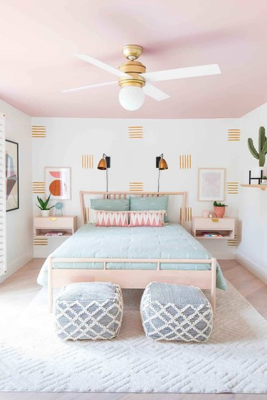 Modern bedroom with pink ceiling and hand painted accent wall.