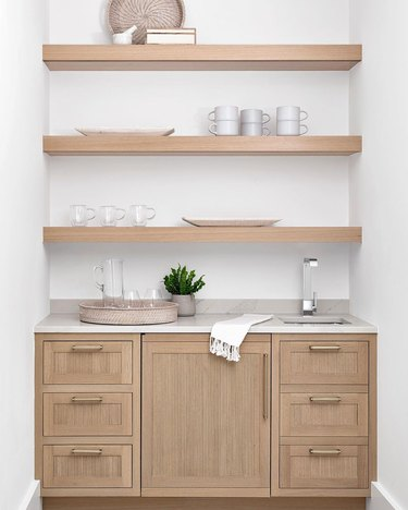 reeded cabinets and drawers in wood breakfast bar