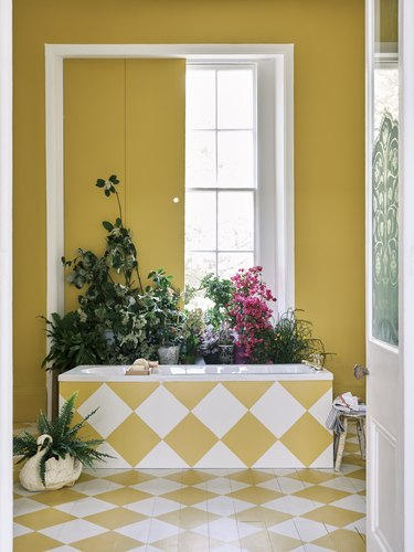 interior with yellow walls and white and yellow tiled floor