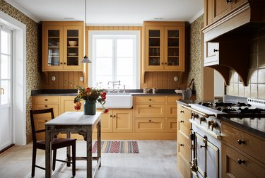 yellow kitchen with complementary floral wallpaper