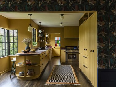 yellow kitchen with wood countertops