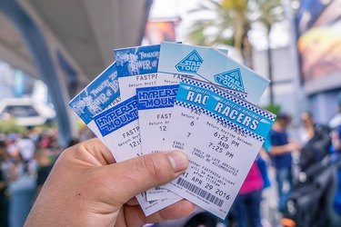 disney fastpasses in person's hand