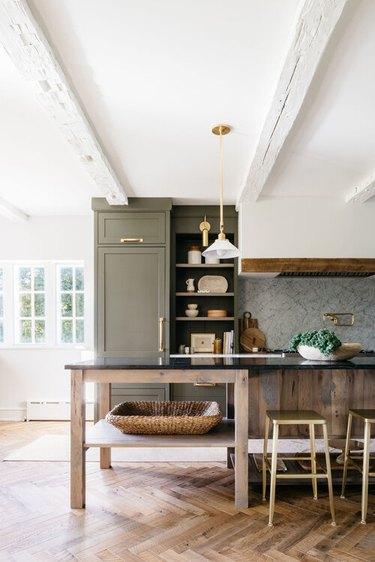 kitchen herringbone flooring with green cabinets
