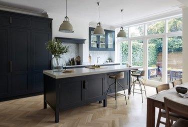 herringbone kitchen flooring with black cabinets