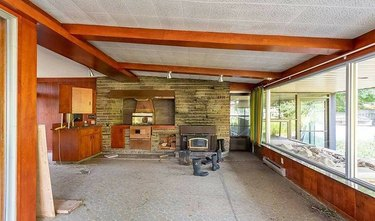 abandoned 1970s mansion living room with wood panels