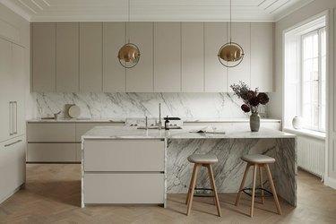 Scandinavian kitchen with herringbone wood flooring