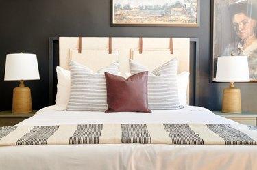 dark charcoal gray bedroom with beige bedding