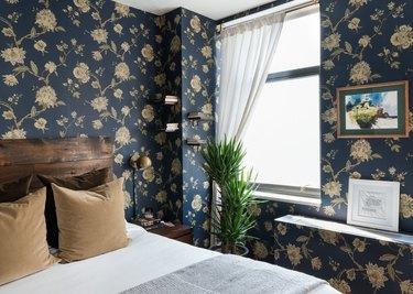 dark bedroom with floral wallpaper