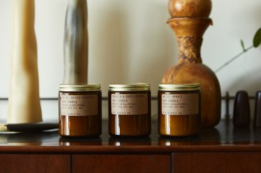 pf candle co seasonal scents on wood table