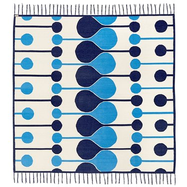 blue and white graphic print throw