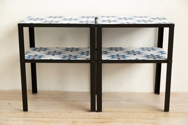 Two tables side by side with patterned tiles