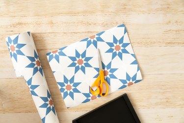 Wallpaper and scissors