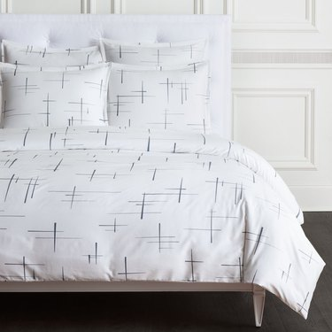 black-and-white crossed bedding