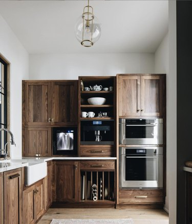Kitchen with brown wood cabinets and a farmhouse sink.