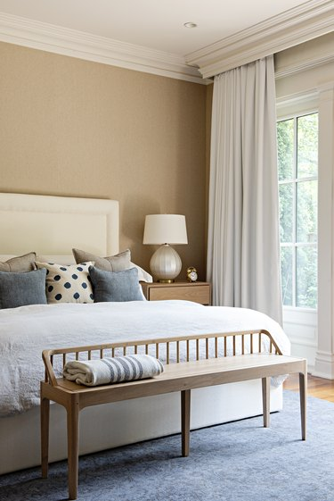 small bedroom with floor to ceiling window treatments