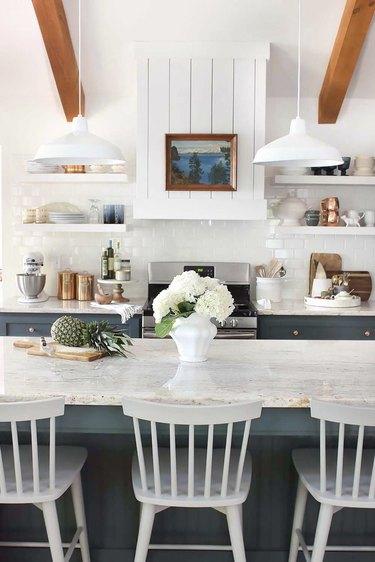 white granite countertop in white vintage-inspired kitchen