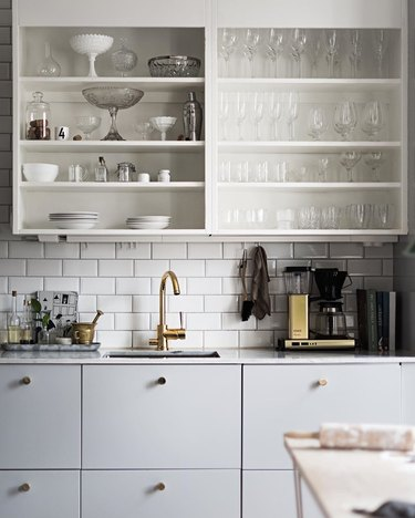 modern gray kitchen with white open shelving