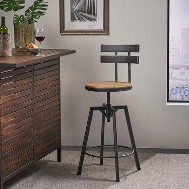 Adjustable bar stool with back