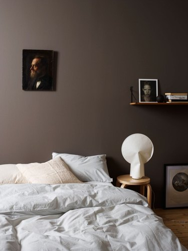 dark bedroom with chocolate brown wall color