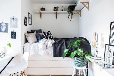 small bedroom with IKEA dressers below bed