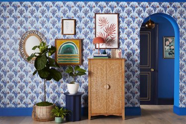 room with blue patterned wallpaper