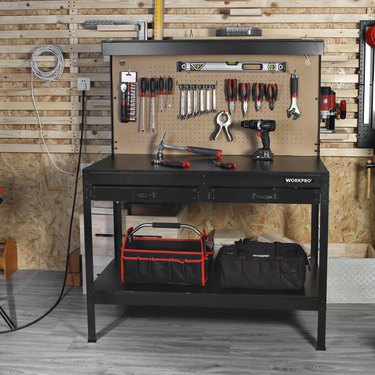 black workbench with light and pegboard