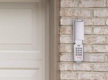 Overhead Door wireless garage door keypad on brick garage exterior