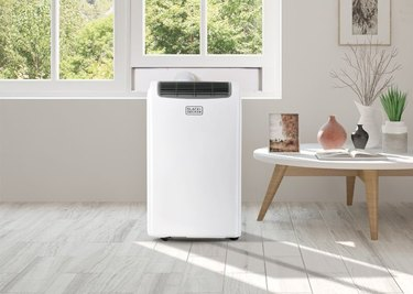 White portable air conditioner in white and gray living room
