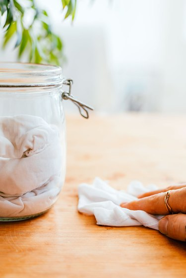 Use reusable cloths for dusting and polishing wood furniture