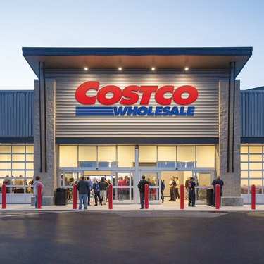 costco wholesale store sign with people outside