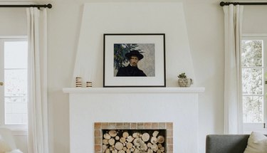 vintage painting print of a man in black hat on white fireplace