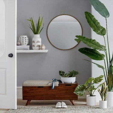 Circular mirror with plants and bench