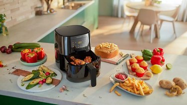 philips essential airfryer on countertop with food