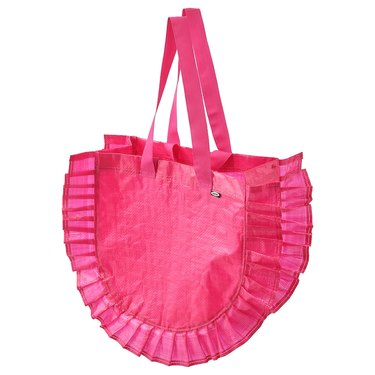 pink shopping bag with handles and frill on the sides