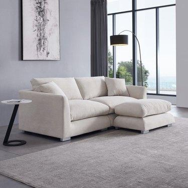 Feather Sofa + Ottoman, $1,499.95