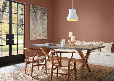 table with chairs and seating area with walls in terra cotta color