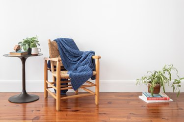 cozy throw blanket and wooden chair