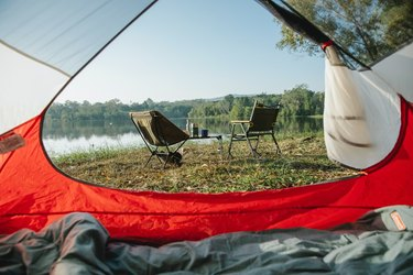 view outside camping tent by lake