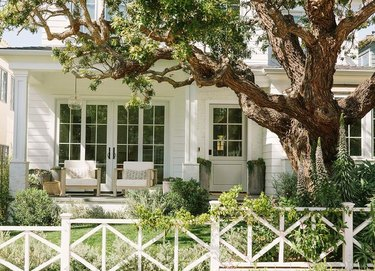 white porch with loungy club chairs