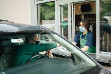 masked customer at starbucks drive-thru
