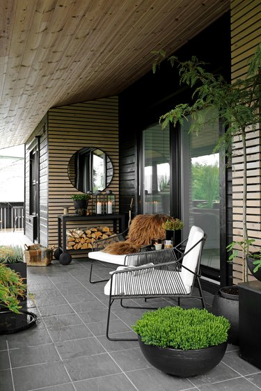 cozy outdoor patio with wood walls and modern chairs